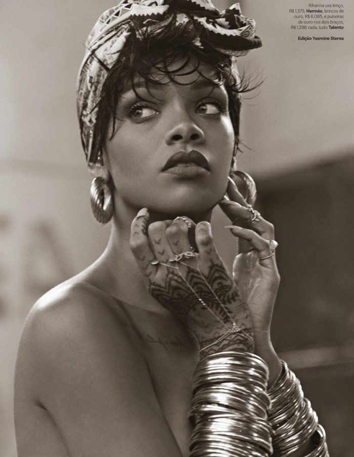Rihanna reveals tan lines as she poses topless for Vogue